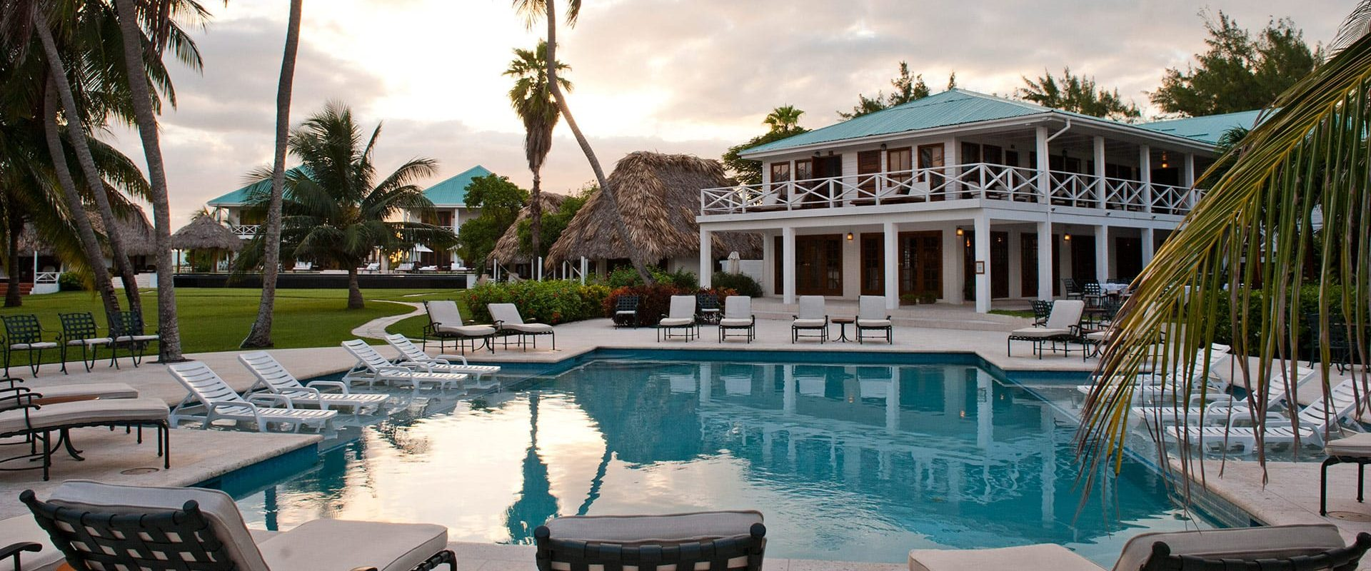 Beach front pool at dusk at Victoria House Resort and Spa, Belize