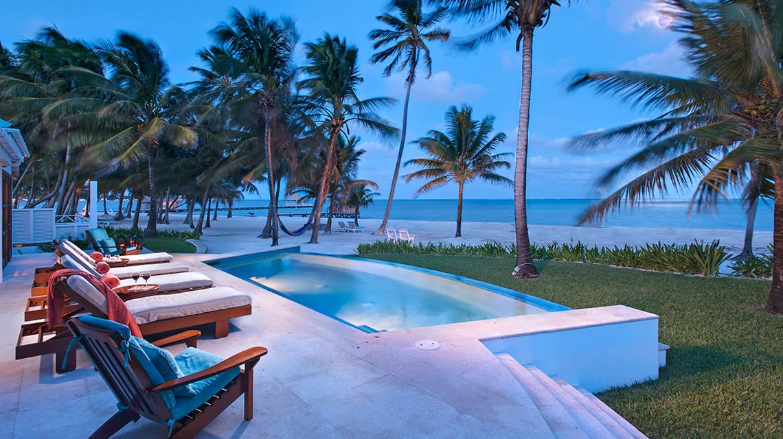 Infinity pool at Casa Playa Blanca overlooking Caribbean Sea at Victoria House Resort and Spa, Belize