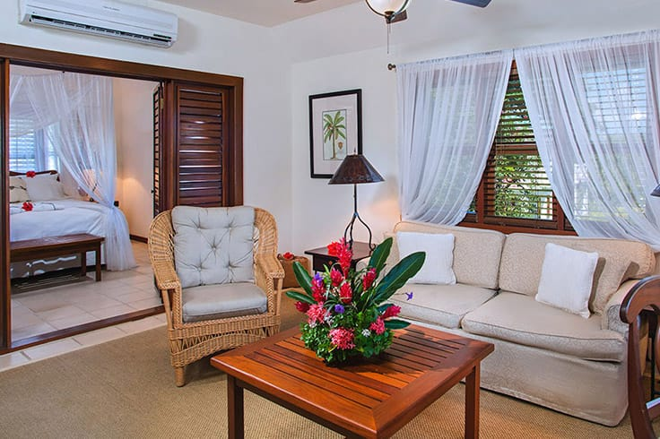 Living room of Coral & Hibiscus Suite at Victoria House Resort and Spa