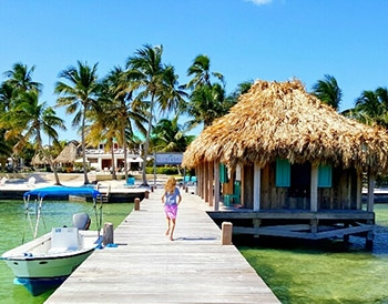 Child running down the dock at Victoria House Resort and Spa, Belize