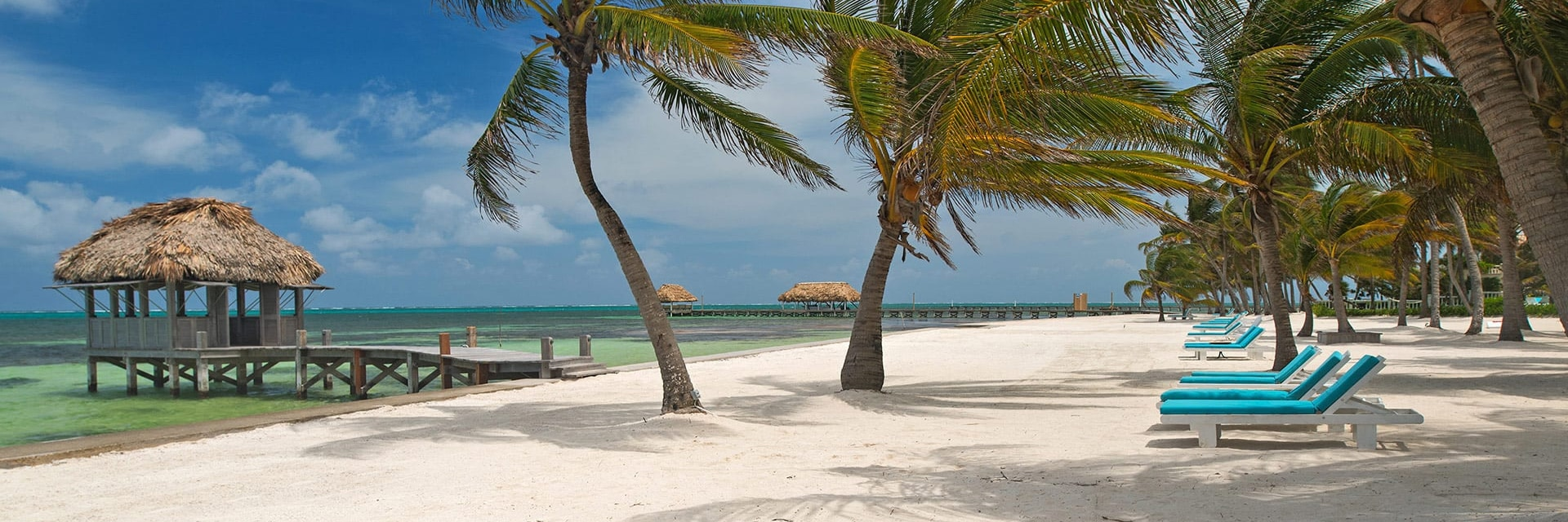 White sand beach and dock at Victoria House Resort and Spa