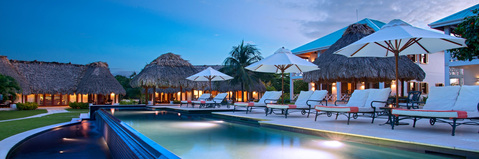 Main infinity pool at dusk, Victoria House Resort and Spa, Belize
