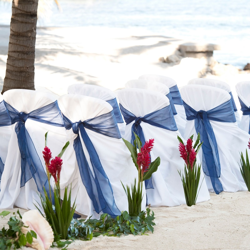 Wedding decorations on the beach at Victoria House Resort and Spa